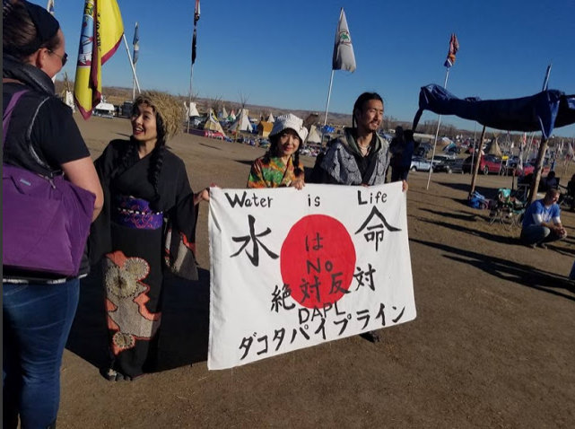 letourvoicesecho-distressflag-didi-indianholocaust-standingrock-japan