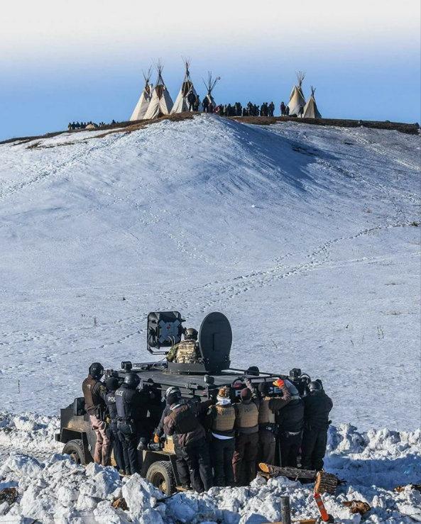 letourvoicesecho-militarizedpolice-indianholocaust-standingrock-prayer
