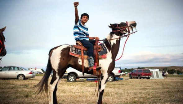 letourvoicesecho-waterislife-indianholocaust-standingrock-warrior-horse