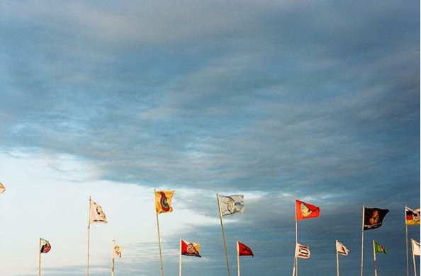 letourvoicesecho-flags-indianholocaust-ocetisakowin